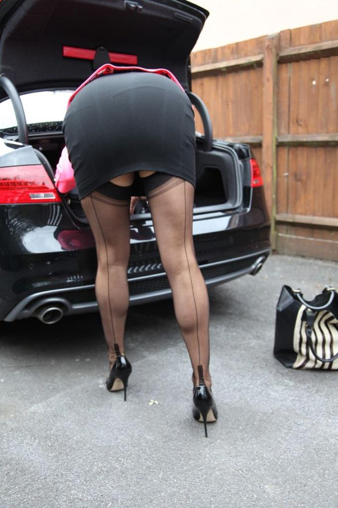 image Milf in leather skirt does nasty lapdance