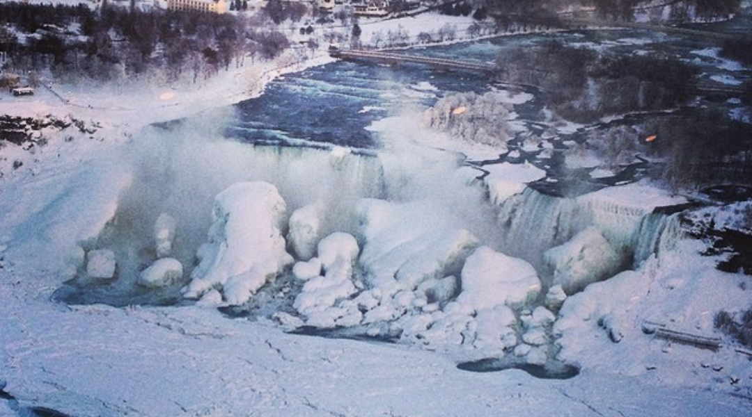 Niagara Falls is freezing over. Here's what it looks like. (Photo by Tracy Vereecken) http://t.co/opfBpYMWP9 http://t.co/i0j8BhApuX