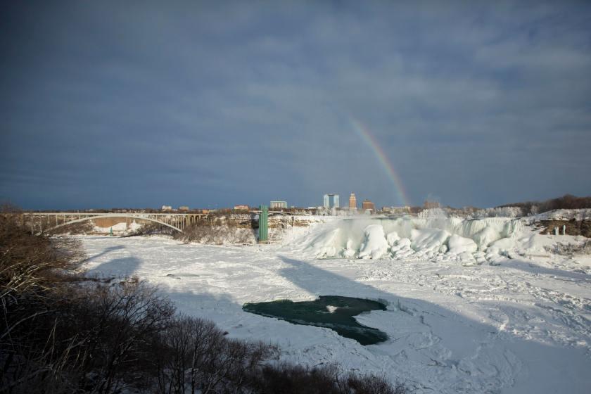 A rainbow over frozen Niagara falls http://t.co/wGf151KKqQ http://t.co/BELQd0NAg9