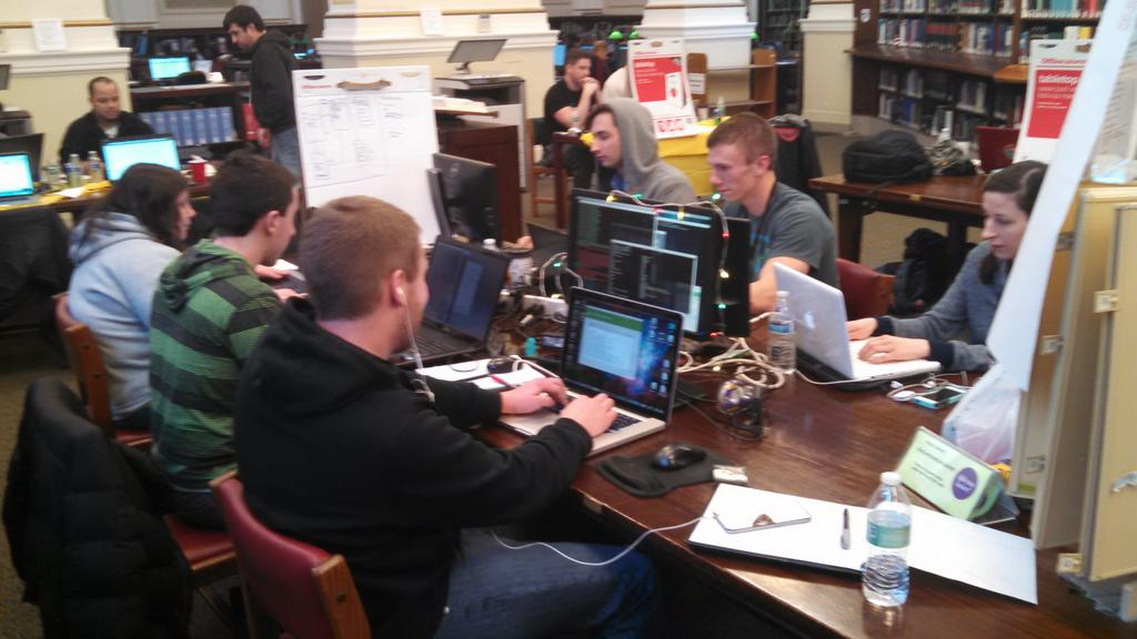 #steelcitycodefest teams at work. +10 @codeforamerica bonus points for holding #CodeAcross event in @carnegielibrary http://t.co/JwuehoUYXC