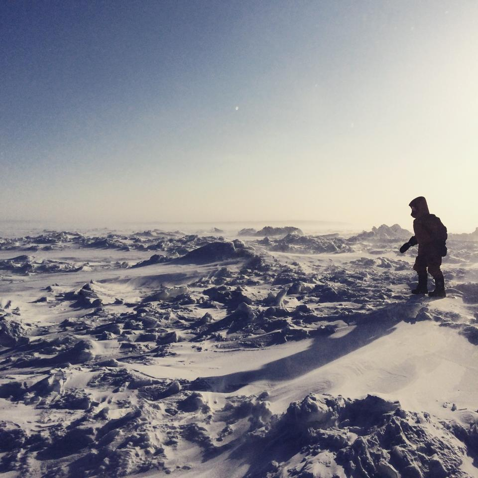 This was my favorite photo from my vacation, my @earthwatch_org teammate Jen walking out on the frozen Hudson Bay. http://t.co/DlBJ11l7gY