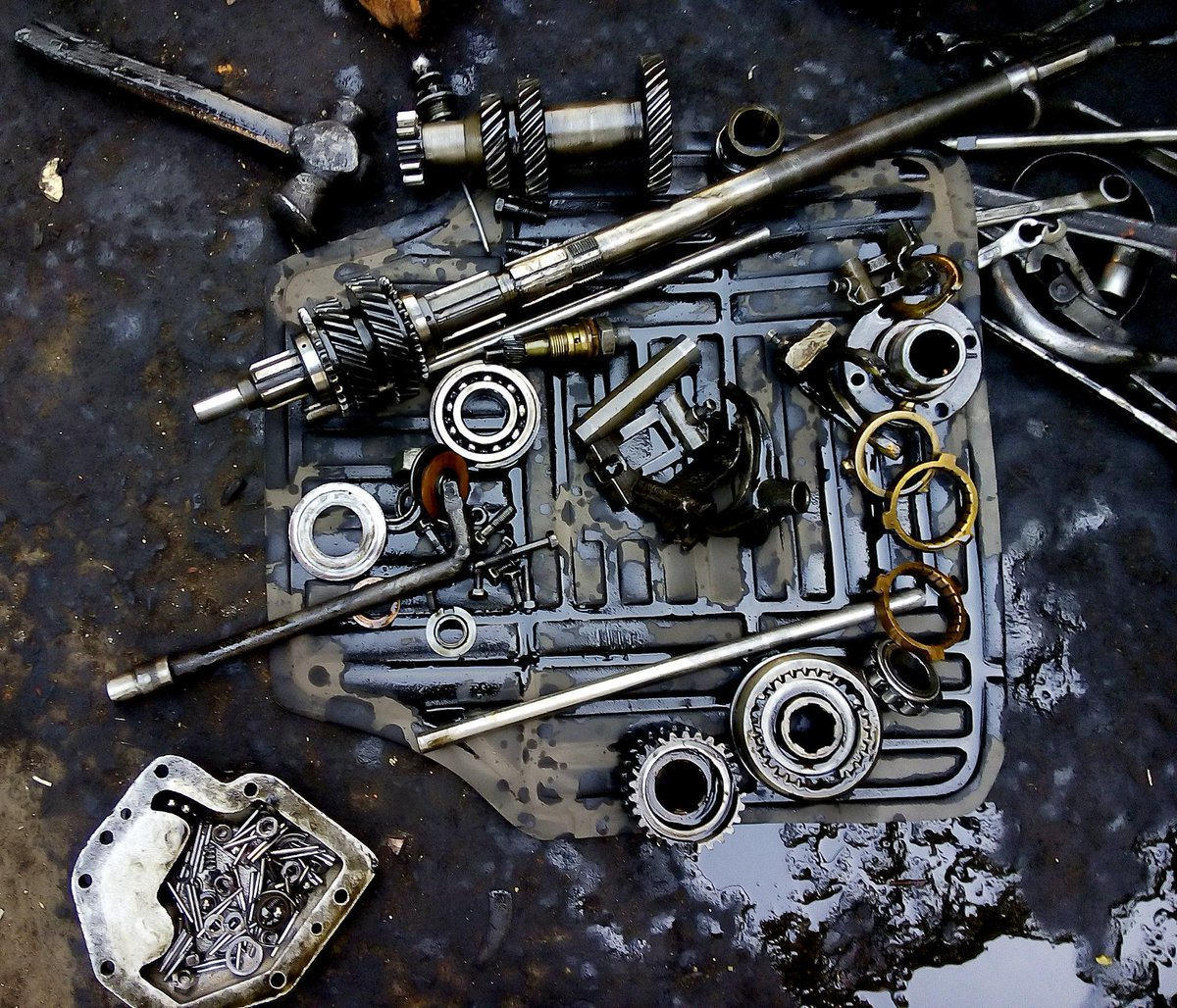 Stripped gear box of an Ambassador taxi on the street behind our office in #Kolkata. #jugaad http://t.co/huhBjQwRs9