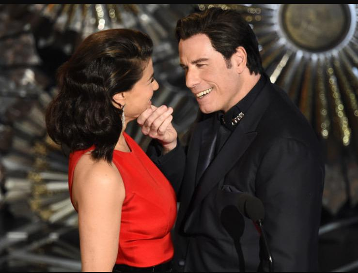 Travolta's odd pawing of Idina Menzel's head at Oscars last night was like he was sizing her up for some Face/Off op. http://t.co/IR7Z5MVc9Y