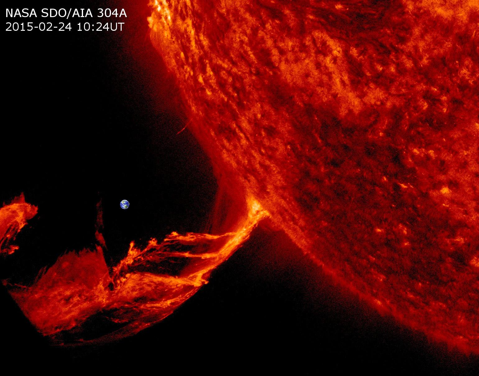 Solar flare, with Earth for scale.  Image credit: Karl Battams and NASA SDO.