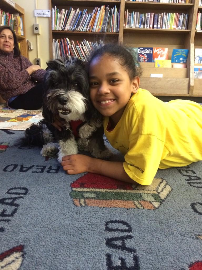 Literacy program helps kids boost their confidence by reading to dogs