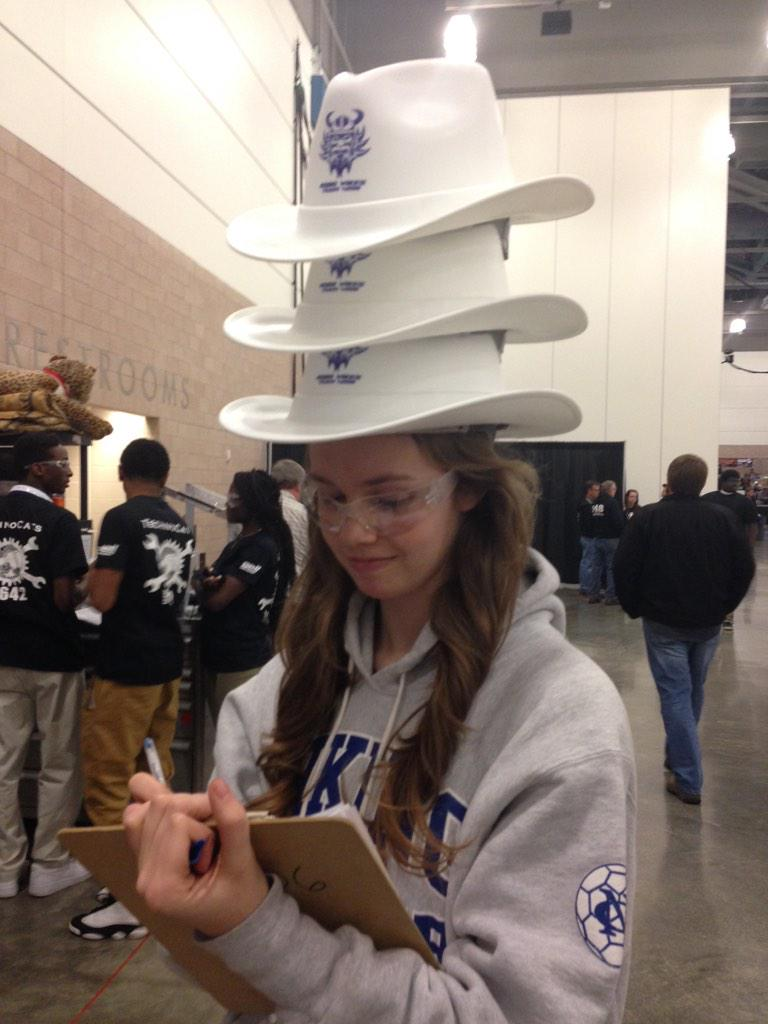 Some people are so Texan they need three hats.