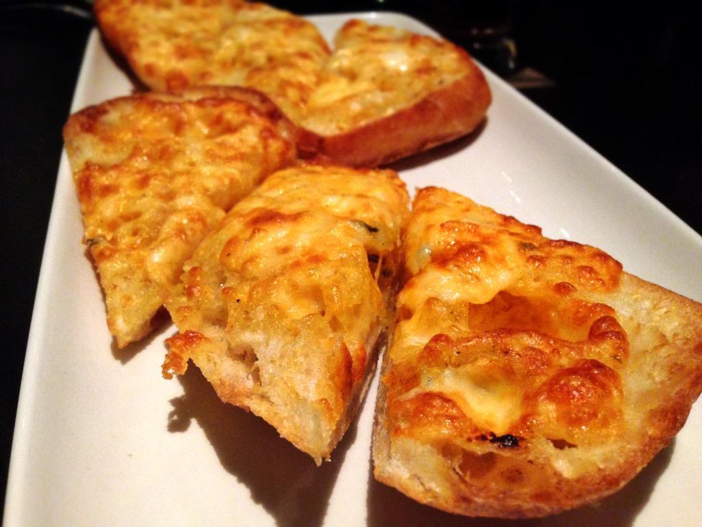 Twitter post: RT @aj_alzuhari: Dangerously addictive garlic cheese toast @TheKeg.…Read more. Opens full post in an overlay