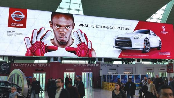 So @usainbolt's face is plastered all around the airport in #Dubai.