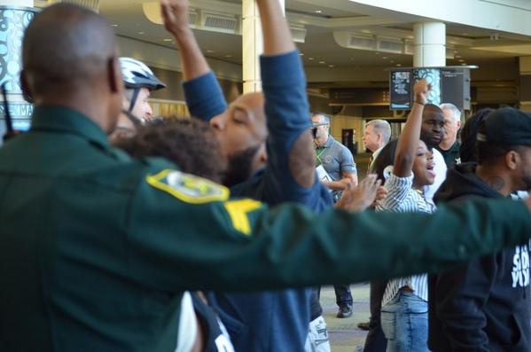 We were #winning. Cops caught up with our folks and slowly pushed them to the front door #Ferguson2Orlando #IACP2014 http://t.co/TrZdN3sAlF