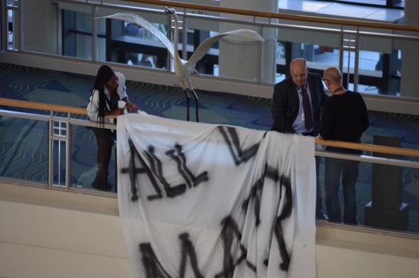 As a session ended in the ballroom, @she_RIKA dropped a banner on the #IACP2014 while HUNDREDS of officers watched. http://t.co/UNQMLtlCEv