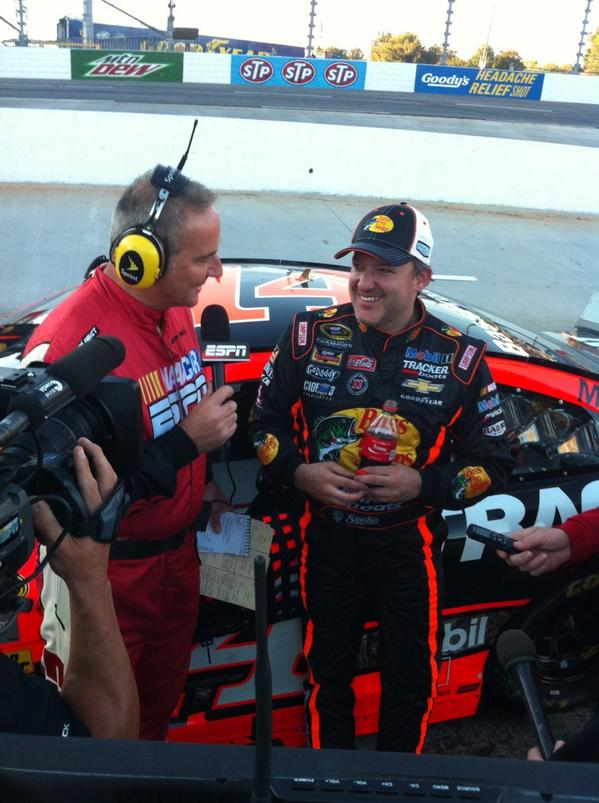 Tony Stewart grins during his post race media on Sunday