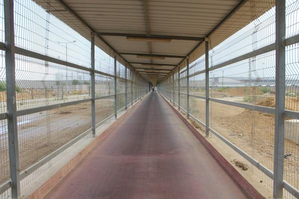 Contrast that with the mile-long cage-tunnel at Erez Crossing... #Gaza http://t.co/n7zLVouMGI