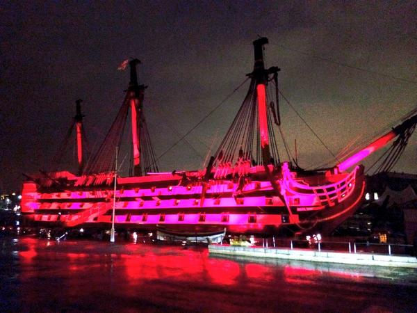 HMS Victory changes colour for the first time in history for Breast Cancer Awareness Month. http://t.co/p0vYpHsFzi