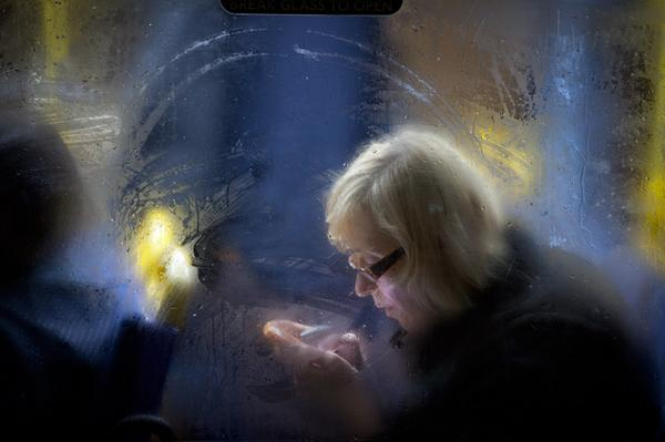This is will be my third winter photographing commuters going home in the dark and wet > http://t.co/SIqBWpnfCR