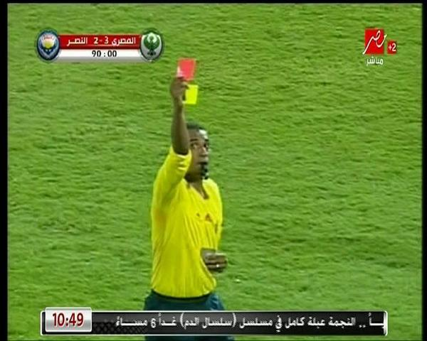 orange egyptian ref gives simultaneous yellow and red card to