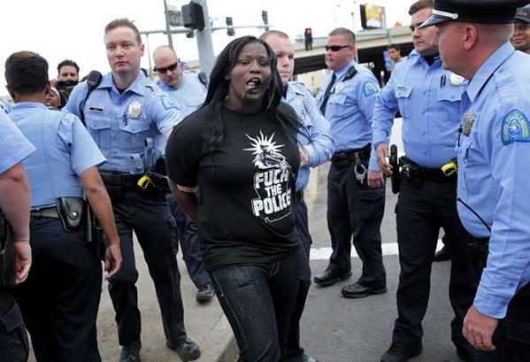 Watch video: Black Mike Brown female protester cusses out spits at white person outsite St. Louis Dome