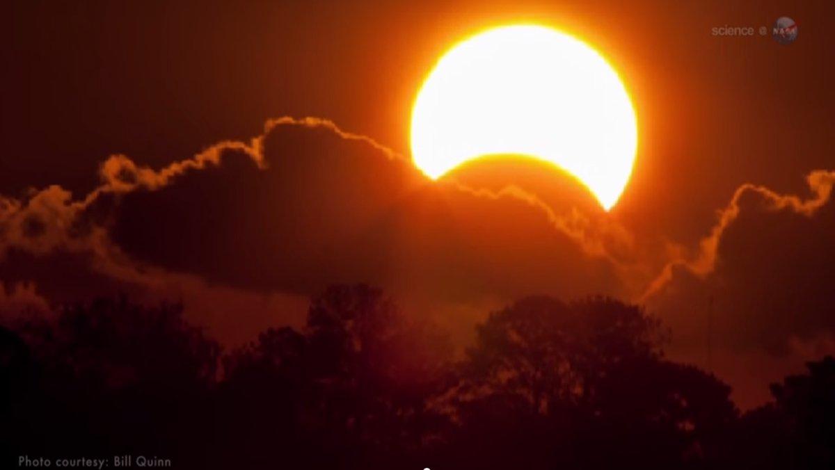 Moon clipped sun like a fingernail during eclipse - CNN.com