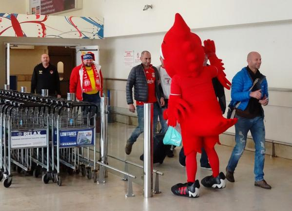 #MightyRed was at @LPL_Airport to greet the @LFC fans flying in from Oslo ahead of the @realmadrid clash! #LFC http://t.co/X5L0vyyuLI