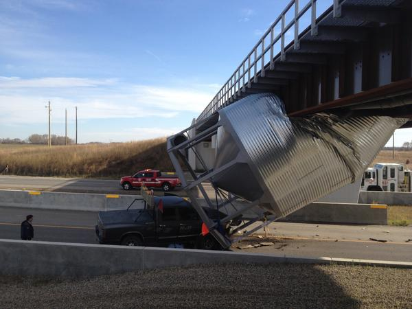 Oops! RT @thebrandonsun: Grain bin wedged under rail bridge on Eastern Access Route #bdnmb http://t.co/K7FWBqLC0G