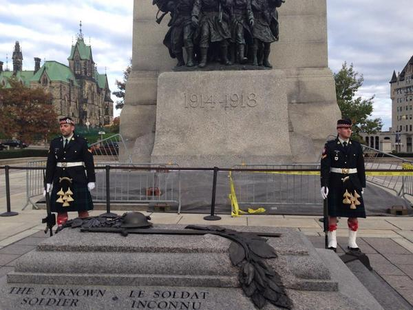 Cpl. Nathan Cirillo pictured on the left, minutes before he was shot at the War Memorial today. #cbcOTT #OTTnews http://t.co/Je9SsfJXYm
