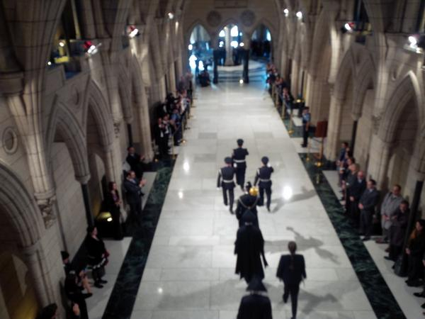 Applause breaks out as the Sgt at Arms, Kevin Vickers, passes. (He's the one with the Mace.) #hw http://t.co/GwlRHKXUhd