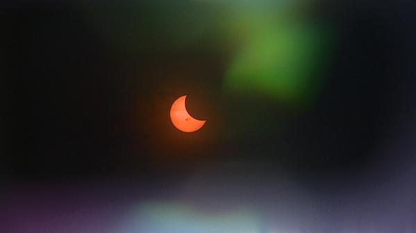 Solar #eclipse right now as seen from Denver. http://t.co/YJodusO1qv