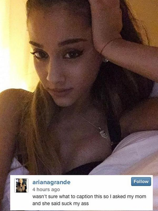 Ariana Grande flashes her cleavage in sexy selfie from bed