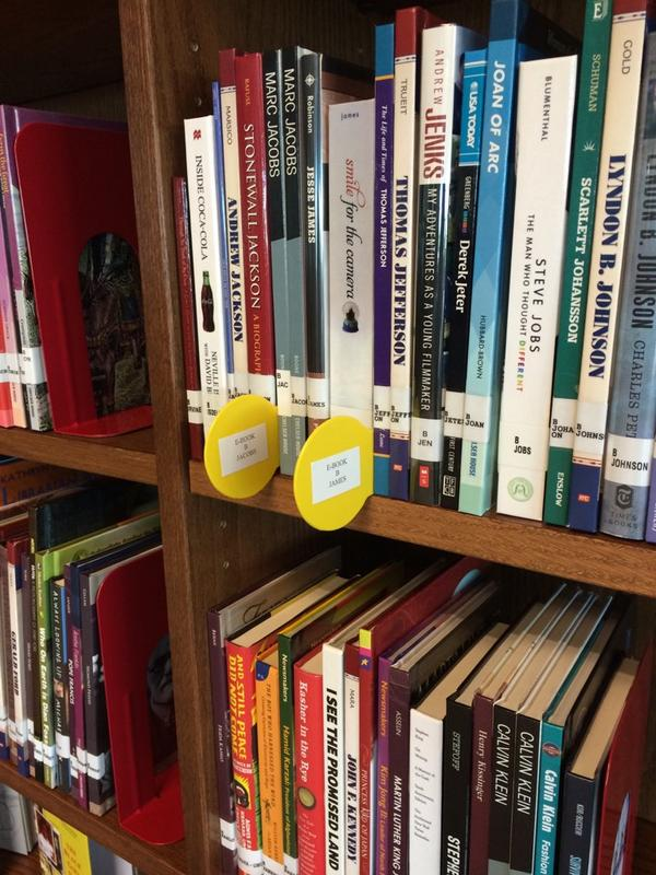 See the shelf markers? Those are where e-books would be if they were hard copy! Genius!! #tlchat #txlchat #leapesc11 http://t.co/YX3UGMLidG