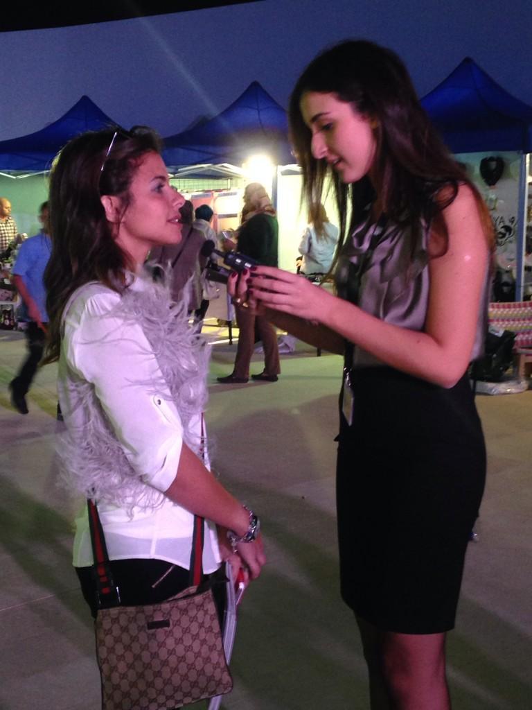 @na_elguiddawy interviewing an AUCian attending the #CFF3. #JRMC2202 #JRLWeb http://t.co/XivPZpHCJb