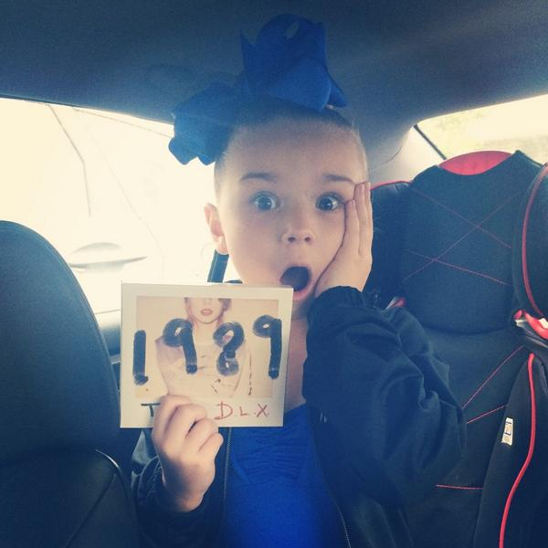 LuLu is a bit excited about #1989 as you can see! Congrats @taylorswift13 on another genius record that is on repeat! http://t.co/m5opJ4IO3O