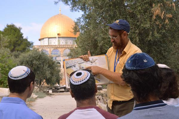 Yehudi Glick - on Temple Mount showing plans for Third Temple