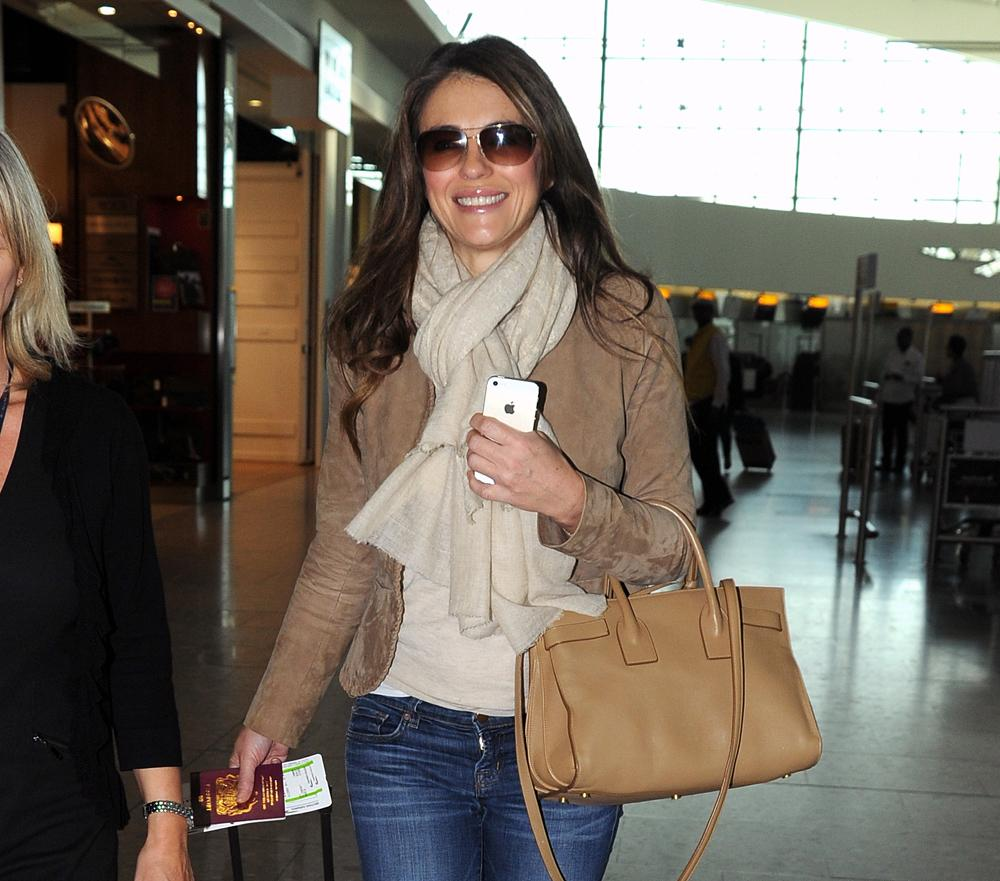 Elizabeth Hurley is the Latest Star to Travel with Saint Laurent http://t.co/50sjEobiF4 http://t.co/VjWCB4uFQY