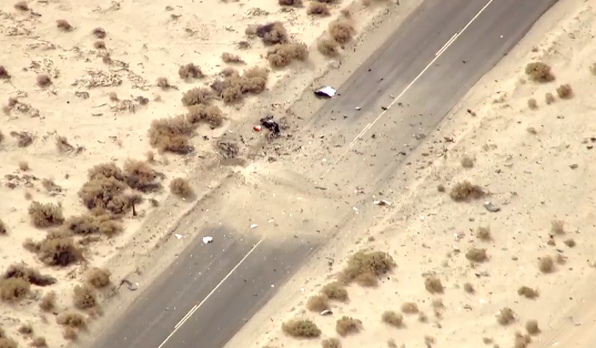 Live video: Debris scattered across the roadway at Virgin Galactic SpaceShipTwo crash site. http://t.co/jinlSt3nDT http://t.co/et2zGBnYr9