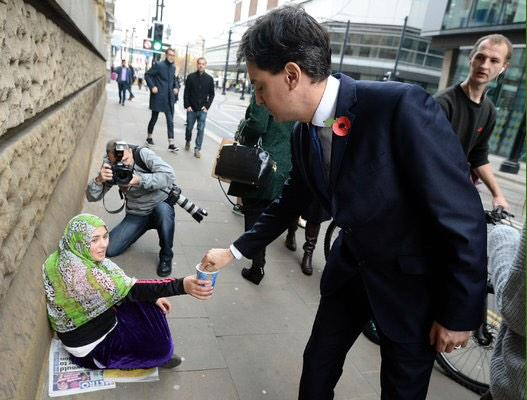 Ed gives change to a homeless woman (first pic); the media run with other two. Relentless, politically driven attacks http://t.co/7lXlMGNSk8