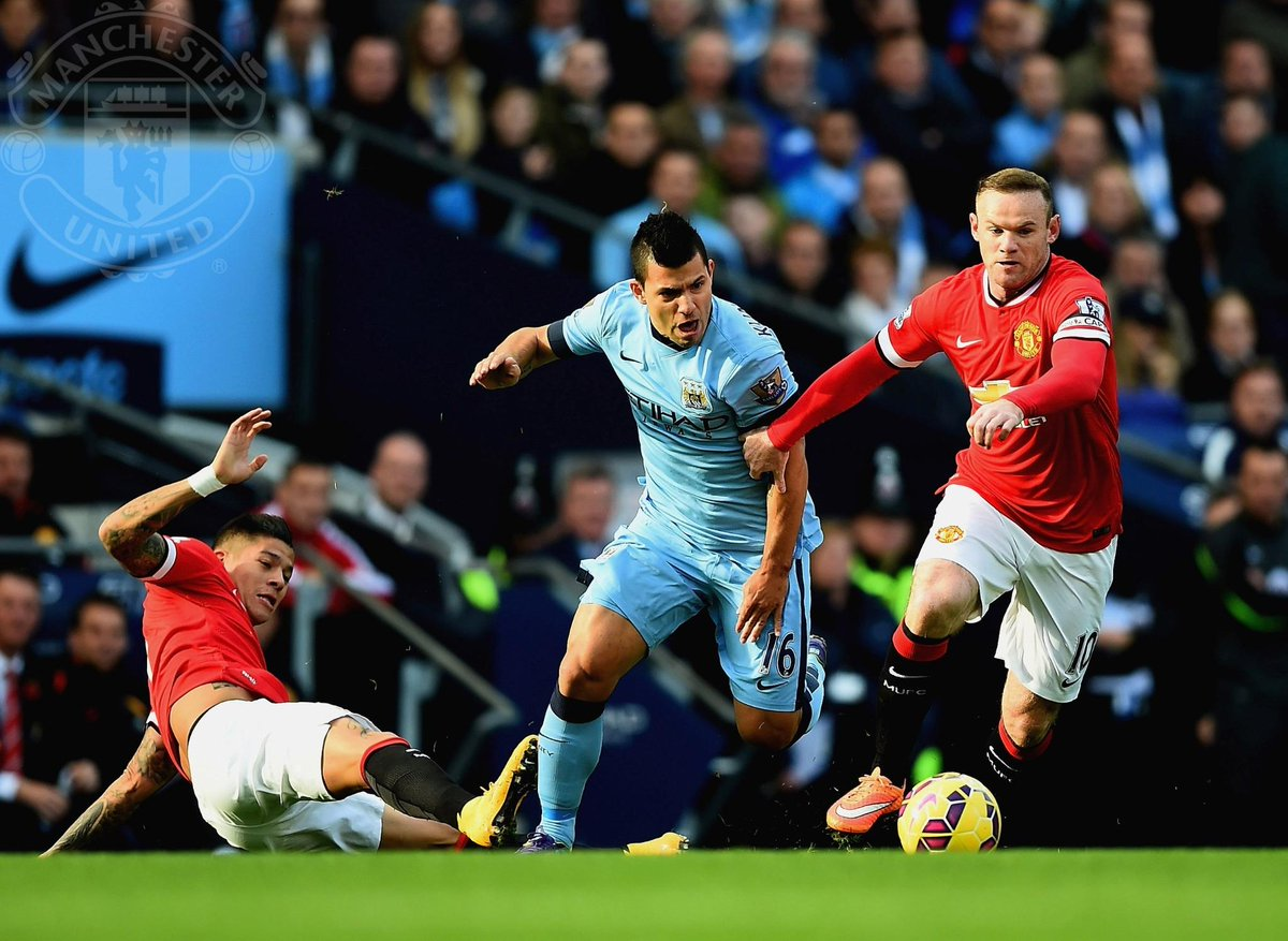 """Manchester United on Twitter: """"PIC: Wayne Rooney and Sergio Aguero battle for the ball in the Manchester derby. #mufclive http://t.co/M0TwaNAWnm"""""""