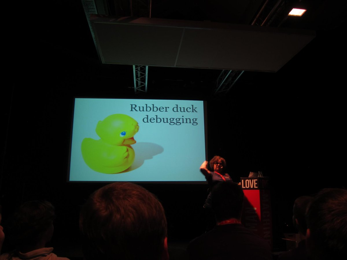 .@DanielleSucher throwing rubber ducks at the audience to help them debug. #Oredev http://t.co/jyzLQqsDsJ