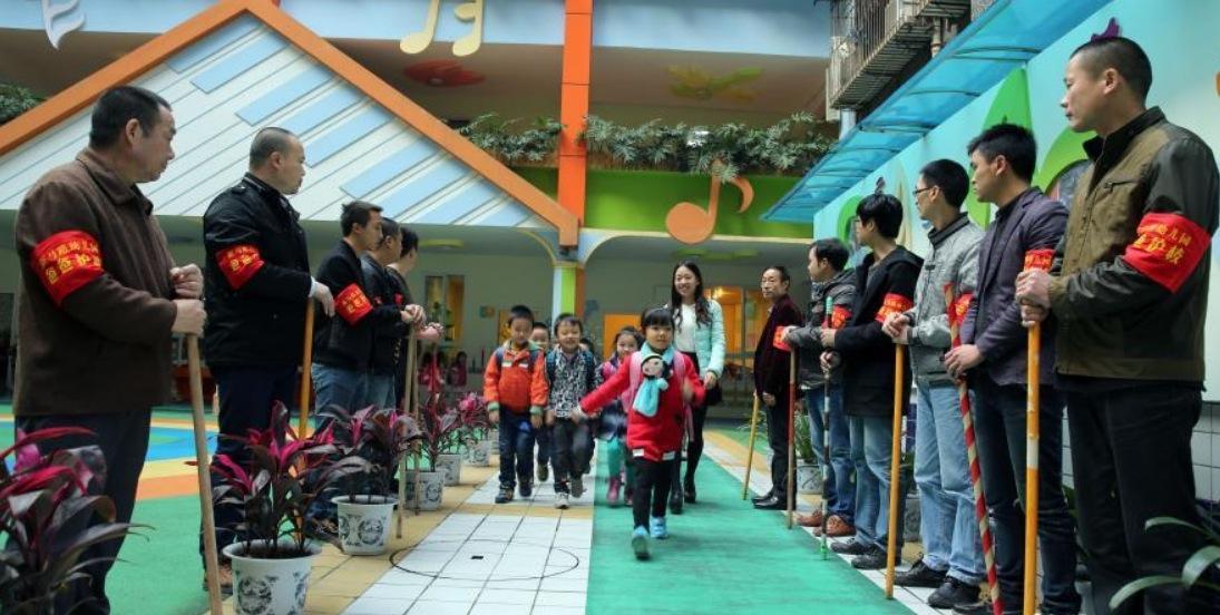 Fathers Patrol Outside A Kindergarten In Luzhou Sichuan Wed As