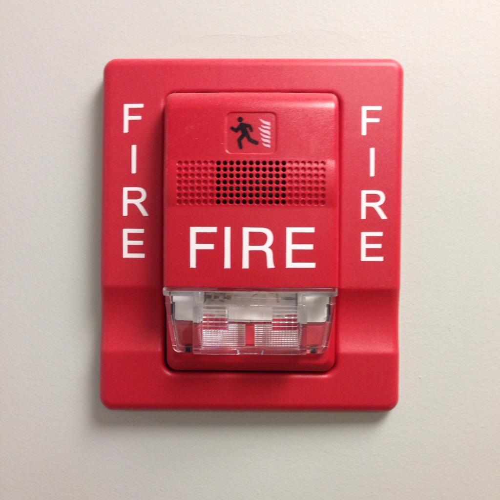 .@ilovetypography good timing, I saw this fire alarm at the doc's using both Helvetica AND Arial. http://t.co/2W0XqYrtfQ