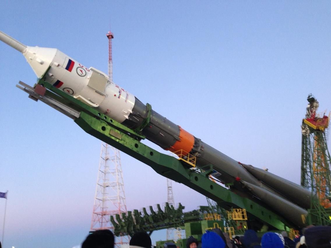 Soyuz rocket at the pad getting lifted from the horizontal to the launch position. Amazing to watch. http://t.co/b8NmR1nwCu