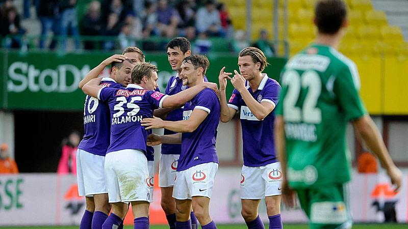 Shikov and teammates celebrate a goal