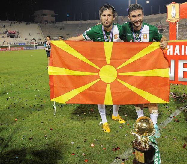 Tasevski and Ilijoski celebrate with the Macedonian flag
