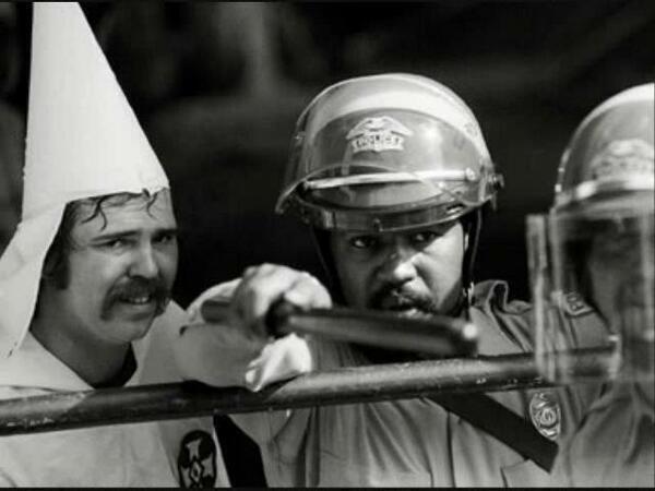 Image result for black policeman protects kkk member
