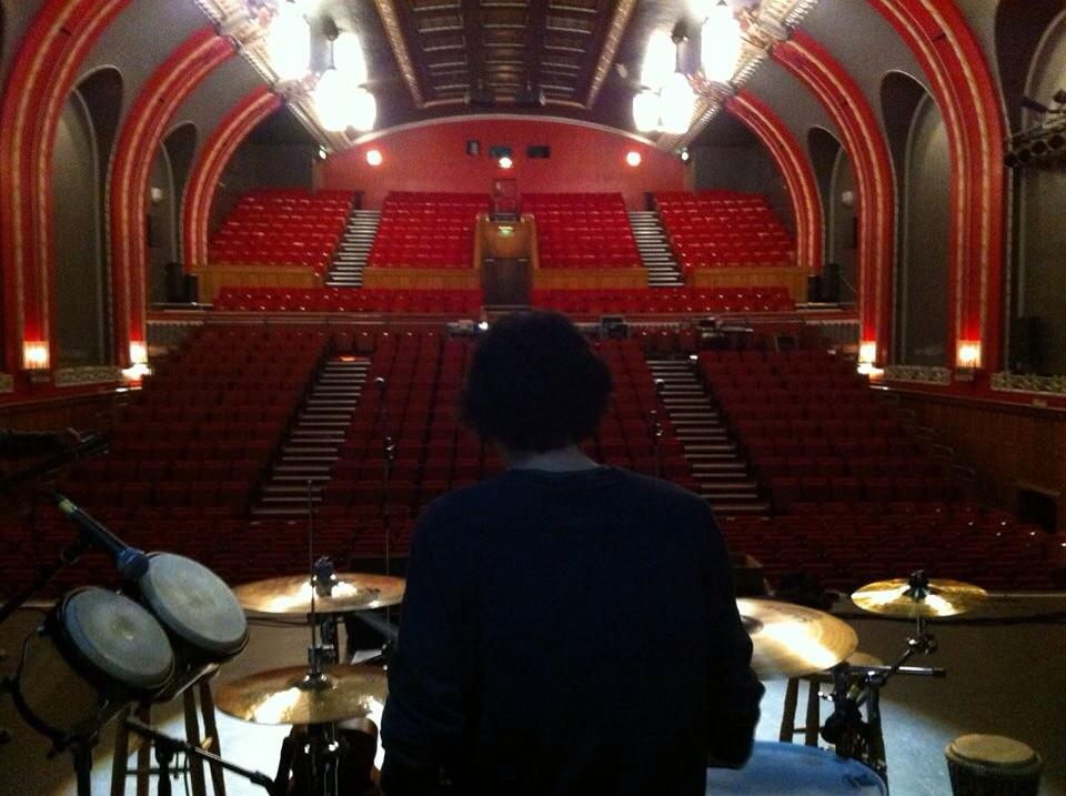 Here's the back of my head and some soon-to-be-filled theatre seats in Catford.   I am yet to see a single cat. http://t.co/vvzn6y0Y2w