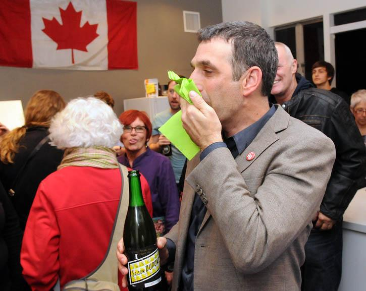 New #newwest councilor @NWimby couldn't wipe the smile off his face. But he did have to wipe the fizzy beer off it http://t.co/SlMSGf00yv