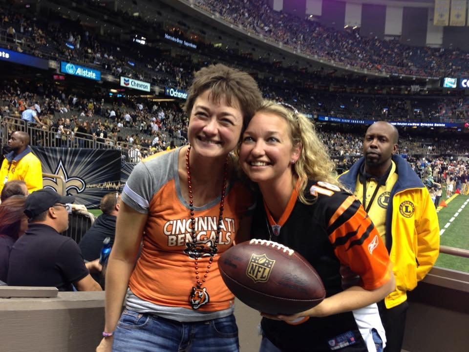 Nice that the @Saints gave this @Bengals fan a ball after a Saints fan stole hers. Anyone know who she is? #Classy http://t.co/Yjl2xbcEr8