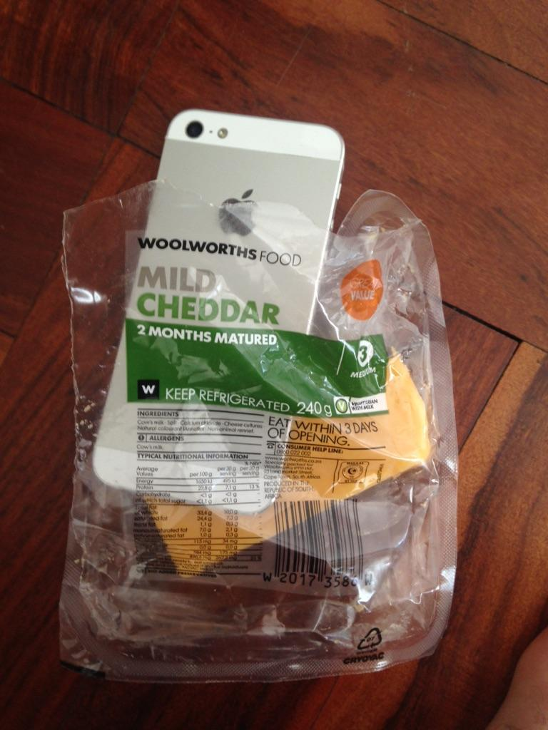 Just found an iPhone in my @WOOLWORTHS_SA Mild Cheddar Cheese. WTF http://t.co/4CSSXboiFp