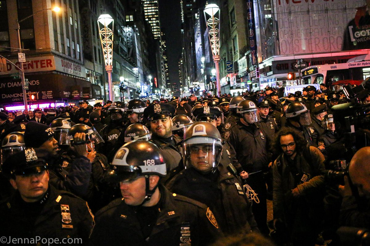 Insane amount of cops in an intersection during one of the #JusticeForEricGarner marched in NYC tonight #ICantBreathe http://t.co/8BBwpX8JIo