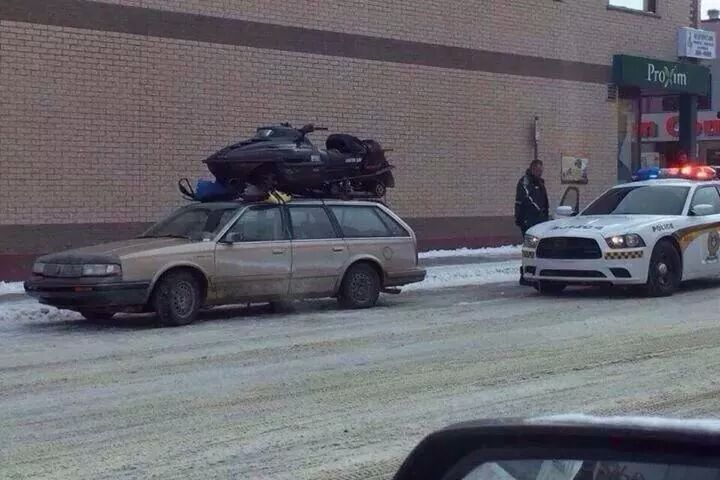 Gotta be a better way to haul the sled. @MSP_Traffic http://t.co/1qd3bONJyE