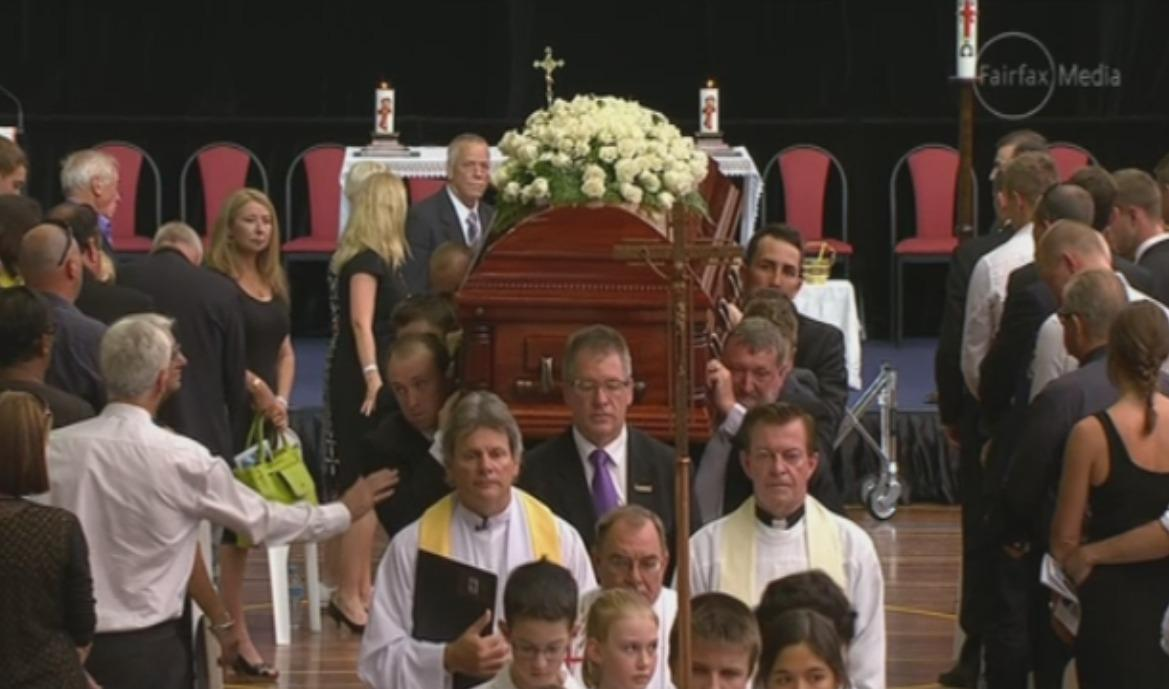 Phillip Hughes funeral service is drawing to a close as the pall bearers carry his coffin down the aisle. http://t.co/nxxZlJBdKa