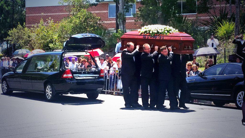 A sad sight. #PhillipHughes casket arrives at Macksville High School. Silence. http://t.co/2CohjQzlCe